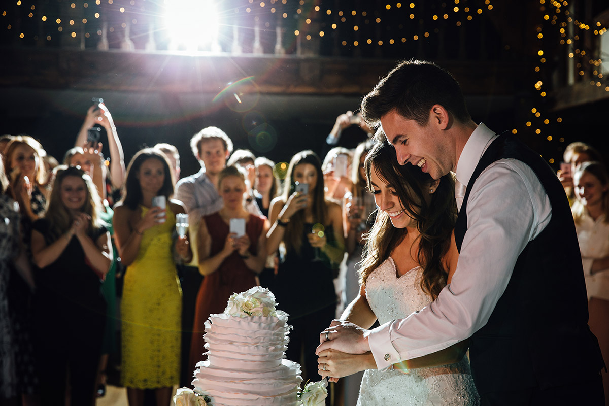Creative Wedding Photography Great Fosters Hotel cake cutting 0065