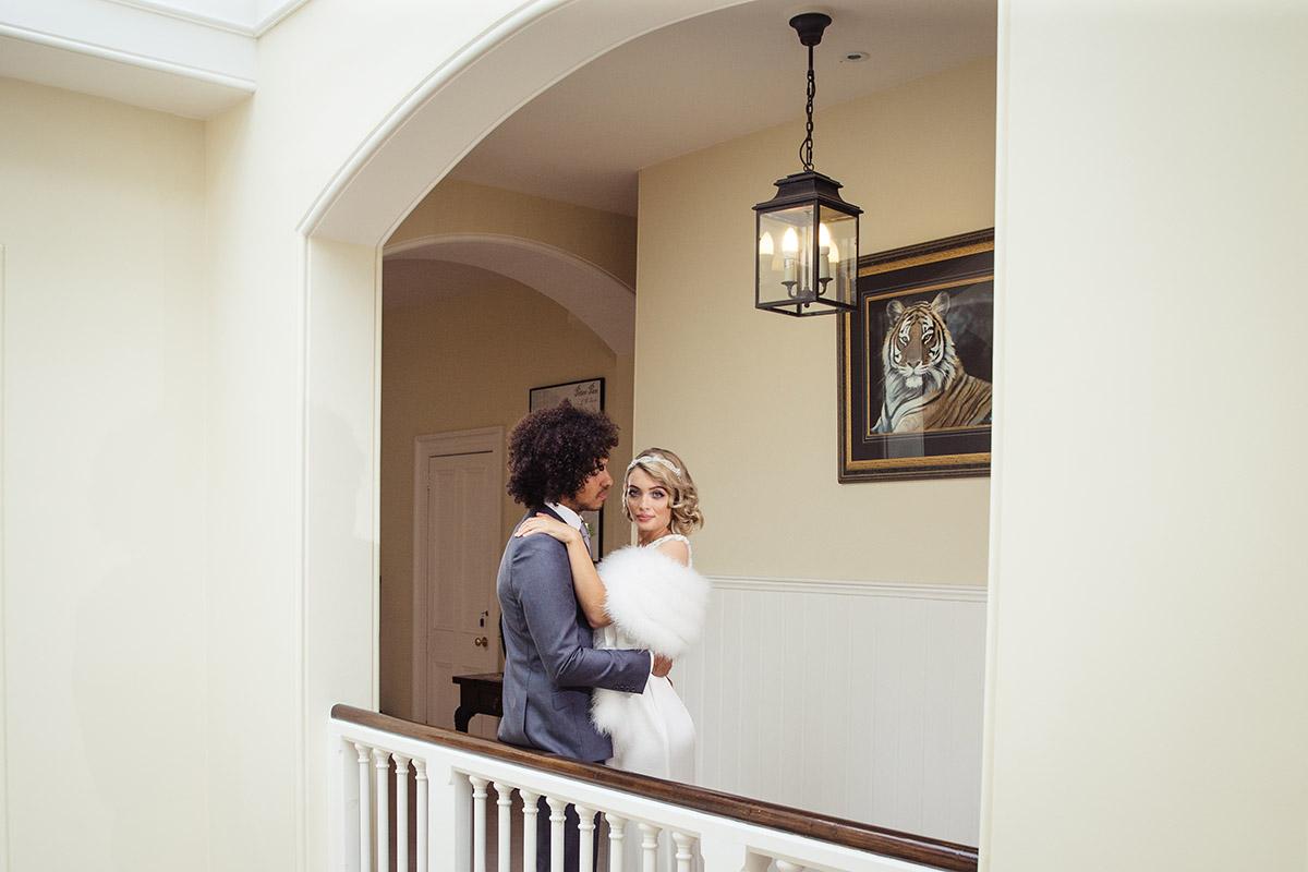Stancliffe Hall Nottingham Wedding Photography Bride & Groom on landing 0011
